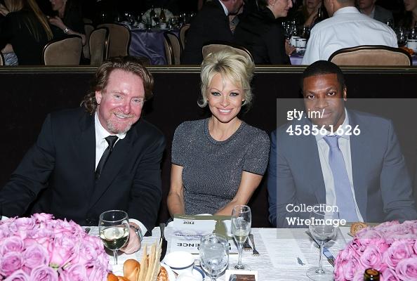 Executive Director of J/P HRO Ron Baldwin, actress Pamela Anderson and actor Chris Tucker